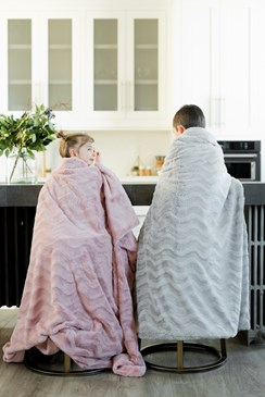 girl and boy sitting on barstools wearing blanket in Arlington Washington home kitchen