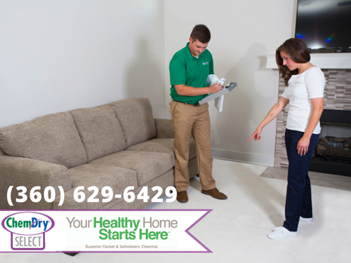 "Chem-Dry Select graphic with text ""your healthy home starts here"" phone number (36) 629-6429, Chem-Dry technician taking notes while woman points to white carpet in living room in Arlington WA"